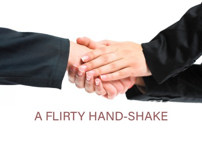Two handed handshake flirting